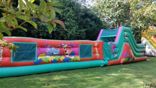 56ft jungle themed assault course in a field surrounded by trees