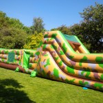 50ft army inflatable assault course in front of trees