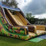 inflatable army slide in a football field