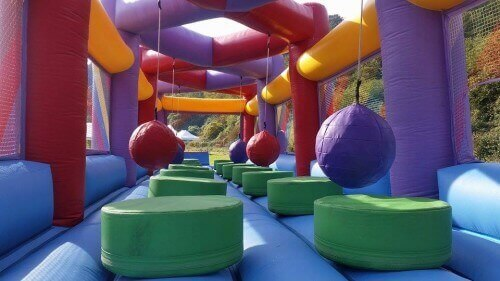 colourful inflatable ball run challenge with platforms to jump onto