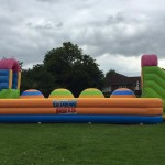 colourful big balls challenge inflatable in a field